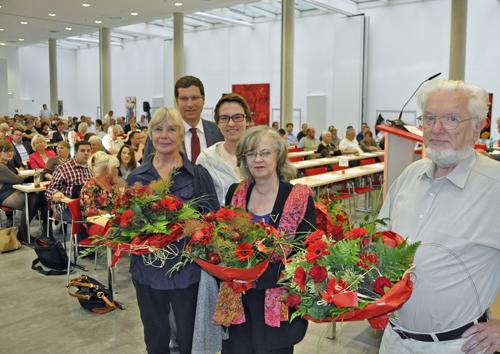 """Thomas Eiskirch dankte den """"Gesichtern"""" der Bürger- und Wählerinitiative (BWI), die sich auf Plakaten für eine sozial Politik in Bochum und auf europäischer Ebene eingesetzt haben."""